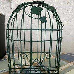 Green metal cage by home interiors